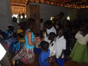 Praying after teaching Bible Overview in a village church of Mahagi Territory, DRC